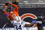 Chicago Bears' Allen Robinson (12) makes a touchdown reception against Indianapolis Colts' Isaiah Rodgers (34) during the second half of an NFL football game, Sunday, Oct. 4, 2020, in Chicago. (AP Photo/Nam Y. Huh)