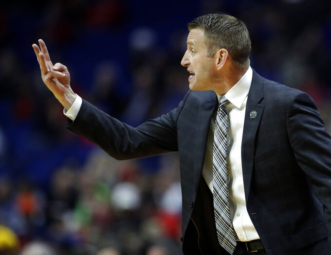 Buffalo head coach Nate Oats talks to his players during the first half of a first round men's college basketball game against Arizona in the NCAA Tournament Friday, March 22, 2019, in Tulsa, Okla. (AP Photo/Charlie Riedel)