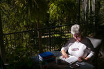 Deb Ware logs an entry in her diary at her home in Fountaindale, Central Coast, Australia, Friday, July 19, 2019. Deb has chronicled the swiftness of her son's downfall in her diary, her fury and fear catalogued alongside all the drugs, the hospitalizations and the broken promises. (AP Photo/David Goldman)