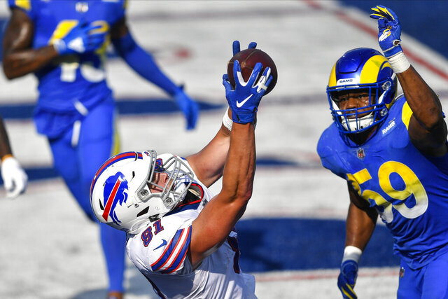 Buffalo Bills' Tyler Kroft (81) catches a pass for the game winning touchdown in front of Los Angeles Rams' Micah Kiser (59) during the second half of an NFL football game Sunday, Sept. 27, 2020, in Orchard Park, N.Y. The Bills won 35-32. (AP Photo/Adrian Kraus)