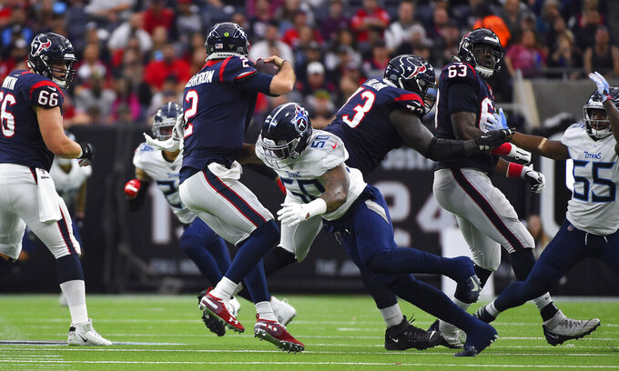 Houston Texans quarterback AJ McCarron (2) is sacked by Tennessee Titans linebacker Derick Roberson (50) during the first half of an NFL football game Sunday, Dec. 29, 2019, in Houston. (AP Photo/Eric Christian Smith)