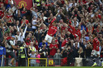 Manchester United's Cristiano Ronaldo celebrates after scoring his side's second goal during the English Premier League soccer match between Manchester United and Newcastle United at Old Trafford stadium in Manchester, England, Saturday, Sept. 11, 2021. (AP Photo/Rui Vieira)