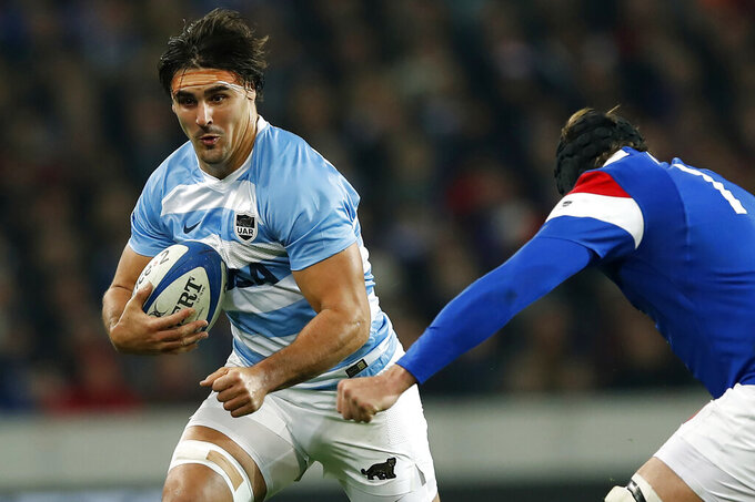 FILE - In this Nov. 17, 2018, file photo, Argentina's Pablo Matera, left, tries to pass France's Arthur Iturria during a rugby union international match between France and Argentina at the Pierre Mauroy stadium, in Lille, northern France.  Argentina captain Matera is set to play Super Rugby for the Christchurch, New Zealand-based Crusaders from the 2022 season. (AP Photo/Christophe Ena, File)