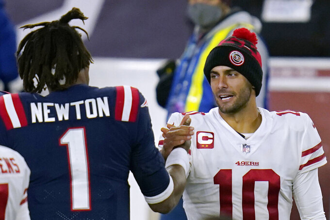 New England Patriots quarterback Cam Newton, left, and San Francisco 49ers quarterback Jimmy Garoppolo speak at midfield after an NFL football game, Sunday, Oct. 25, 2020, in Foxborough, Mass. (AP Photo/Charles Krupa)