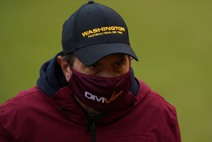 Washington Football Team owner Dan Snyder, walking off the field before the start of an NFL football game against Dallas Cowboys, Sunday, Oct. 25, 2020, in Landover, Md. (AP Photo/Susan Walsh)