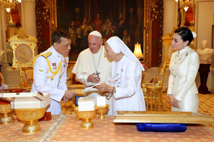 In this photo released by The Royal Household Bureau, Thai King Maha Vajiralongkorn talk to Pope Francis, his cousin Ana Rosa Sivori, and Thai Queen Suthida at Dusit Palace Thursday, Nov. 21, 2019, in Bangkok, Thailand. (The Royal Household Bureau via AP)