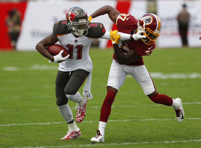 FILE - In this Sunday, Nov. 11, 2018 file photo, Tampa Bay Buccaneers wide receiver DeSean Jackson (11) stiff arms Washington Redskins cornerback Greg Stroman (37) during the second half of an NFL football game in Tampa, Fla. Two people familiar with the deal tell The Associated Press the Philadelphia Eagles have agreed to acquire wide receiver DeSean Jackson from Tampa Bay along with a 2020 seventh-round draft pick for a sixth-round pick this year. The deal is contingent upon Jackson agreeing to a new contract, according to one of the sources who spoke on condition of anonymity late Monday, March 11, 2019 because terms haven't been finalized. (AP Photo/Mark LoMoglio, File)