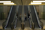 Two women, wearing masks to protect against the spread of coronavirus, take escalators at North train station in Brussels, Wednesday, Aug. 26, 2020. Protective face masks are mandatory in Brussels in all public spaces. (AP Photo/Francisco Seco)
