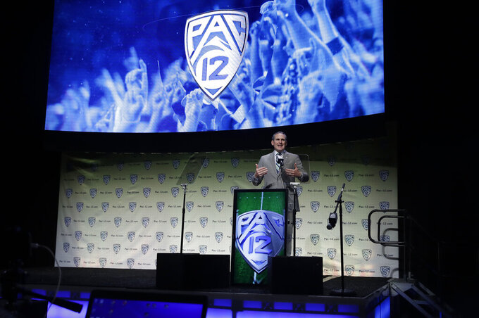 Pac-12 Conference Commissioner Larry Scott speaks during the Pac-12 Conference NCAA college football Media Day Wednesday, July 24, 2019, in Los Angeles. (AP Photo/Marcio Jose Sanchez)