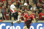 In this Wednesday, May 22, 2019 photo, Lucas Pratto of Argentina's River Plate heads the ball past Leonardo Cittadini of Brazil's Athletico Paranaense during Recopa Sudamericana first leg final soccer match in Curitiba, Brazil. (AP Photo/Andre Penner)