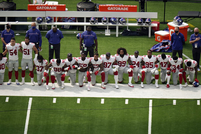 New York Giants players kneel during the national anthem before an NFL football game against the Los Angeles Rams Sunday, Oct. 4, 2020, in Inglewood, Calif. (AP Photo/Jae C. Hong)