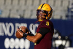 FILE - Arizona State quarterback Jayden Daniels (5) warms up before an NCAA college football game against Arizona in Tucsonm Ariz., in this Friday, Dec. 11, 2020, file photo. Daniels had a superb freshman season as Arizona State's starter, throwing for 2,748 yards and 17 touchdowns with two interceptions. (AP Photo/Rick Scuteri, File)
