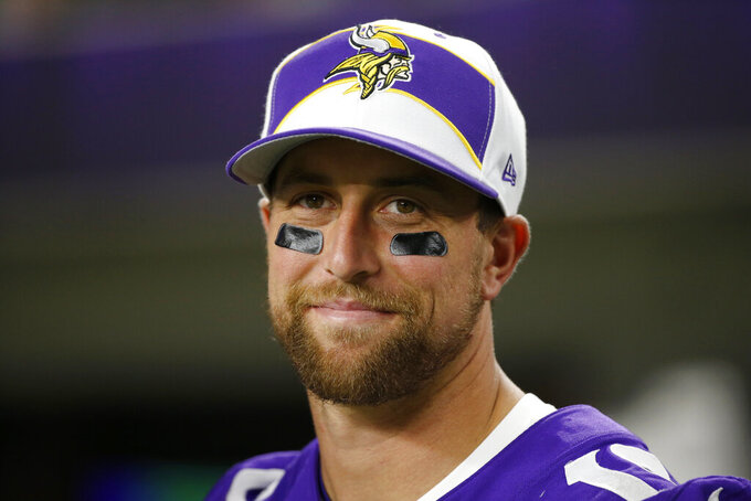 "FILE - Minnesota Vikings wide receiver Adam Thielen watches from the sideline during the second half of an NFL preseason football game against the Seattle Seahawks, Sunday, Aug. 18, 2019, in Minneapolis. The coronavirus pandemic scuttled most college pro days, wiped out all rookie minicamps and obliterated the NFL's traditional offseason. ""Honestly, I probably wouldn't be in the NFL if this would've happened my rookie year,"" said Vikings two-time Pro Bowl receiver Adam Thielen, who went undrafted in 2013 out of Minnesota State but parlayed an impressive weekend at a rookie minicamp into a practice squad job and eventually a roster spot.(AP Photo/Bruce Kluckhohn, File)"