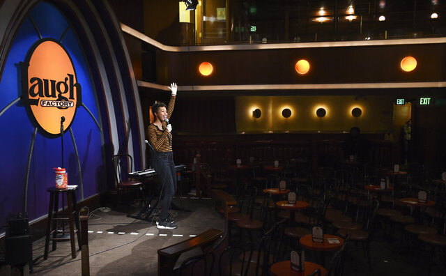 Comedian Daphnique Springs performs to an empty room during a