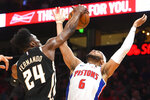 Detroit Pistons guard Bruce Brown (6) is fouled by Atlanta Hawks forward Bruno Fernando during the second half of an NBA basketball game Saturday, Jan. 18, 2020, in Atlanta. (AP Photo/John Amis)