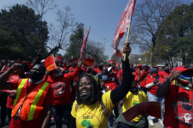 Members of the National Education, Health and Allied Workers' Union (NEHAWU) protest at the government's Union Buildings in Pretoria, South Africa, Thursday, Sept. 3, 2020. NEHAWU are calling for safer working conditions for front line workers after 240 lost their lives to COVID-19. (AP Photo/Themba Hadebe)