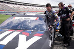 Alex Bowman climbs into his car before qualifying in seventh position for the NASCAR Cup Series auto race at Charlotte Motor Speedway on Saturday, May 29, 2021 in Charlotte, N.C. (AP Photo/Ben Gray)