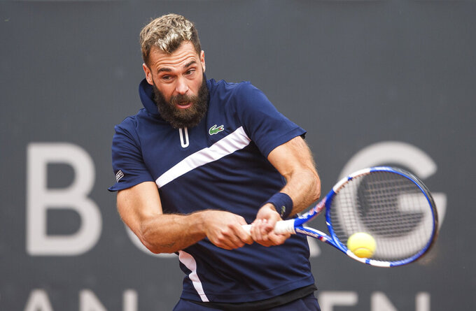 Benoit Paire of France returns during his 1st round tennis match at the ATP Tour - German Open in Hamburg, Germany, Wednesday, Sept. 23, 2020. (Daniel Bockwoldt/dpa via AP)
