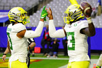 Oregon quarterback Anthony Brown (13) celebrates his touchdown against Iowa State with wide receiver Johnny Johnson III (3) during the first half of the Fiesta Bowl NCAA college football game, Saturday, Jan. 2, 2021, in Glendale, Ariz. (AP Photo/Rick Scuteri)