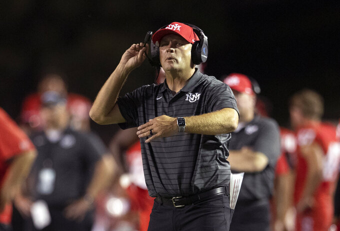 New Mexico coach Danny Gonzales gives instructions to players from the sideline during the second half of an NCAA college football game against Houston Baptist on Thursday, Sept. 2, 2021, in Albuquerque, N.M. (AP Photo/Andres Leighton)