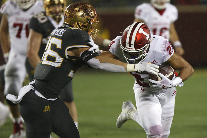 Indiana running back Mike Majette controls the ball against Minnesota's Blake Cashman during an NCAA college football game Friday, Oct. 26, 2018, in Minneapolis. Minnesota won 38-31. (AP Photo/Stacy Bengs)