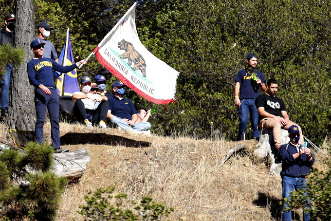 "California fans watch from ""tightwad hill"" during the team's NCAA college football game against Stanford on Friday, Nov. 27, 2020, in Berkeley, Calif. (AP Photo/Jed Jacobsohn)"