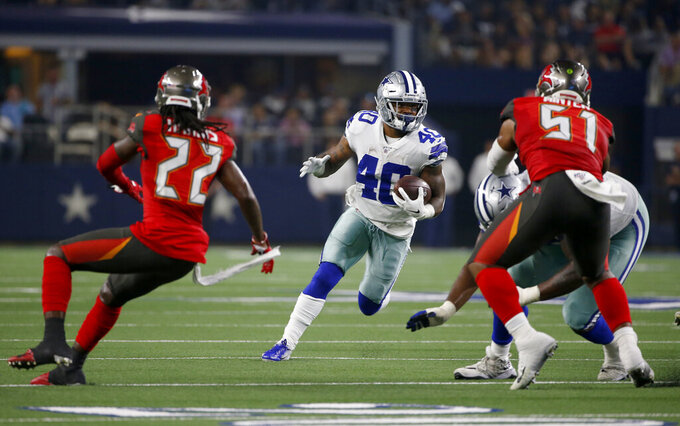 Tampa Bay Buccaneers' De'Vante Harris (22) and Kevin Minter (51) defend as Dallas Cowboys running back Mike Weber (40) runs the ball in the first half of a preseason NFL football game in Arlington, Texas, Thursday, Aug. 29, 2019. (AP Photo/Ron Jenkins)