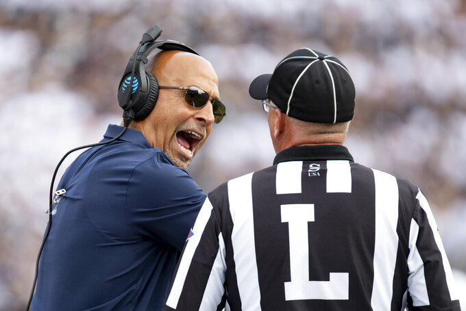 Penn State head coach James Franklin talks with an official in the second quarter of an NCAA college football game against Idaho in State College, Pa., on Saturday, Aug. 31, 2019. (AP Photo/Barry Reeger)