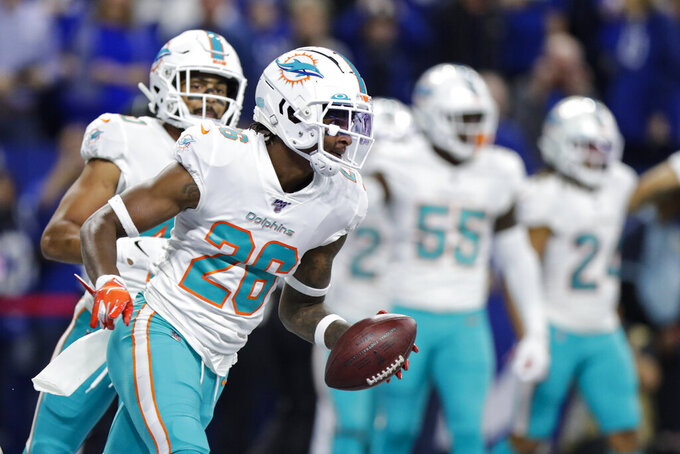 Miami Dolphins defensive back Steven Parker (26) runs to the sideline after an interception in the end zone against the Indianapolis Colts during the first half of an NFL football game in Indianapolis, Sunday, Nov. 10, 2019. (AP Photo/Michael Conroy)