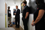 Former U.S. Sen. Dean Heller, second from left, tours the home of Michael Clark, left, at Share Village Las Vegas after announcing a bid for governor of Nevada, Monday, Sept. 20, 2021, in Las Vegas. (AP Photo/John Locher)
