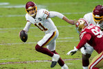 Washington Football Team quarterback Alex Smith (11) scrambles against the San Francisco 49ers during the first half of an NFL football game, Sunday, Dec. 13, 2020, in Glendale, Ariz. (AP Photo/Ross D. Franklin)