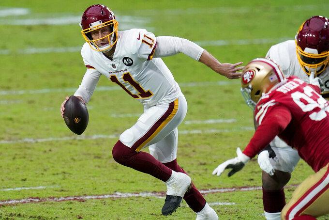 Washington Football Team quarterback Alex Smith (11) scrambles against the San Francisco 49ers during the first half of an NFL football game, Sunday, Dec. 13, 2020, in Glendale, Ariz. (AP Photo/Ross D. Franklin)