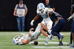 North Carolina quarterback Sam Howell (7) loses the ball after being hit by Georgia Tech defensive lineman Ja'Quon Griffin (95) during the first half of an NCAA college football game Saturday, Sept. 25, 2021, in Atlanta. Murphy recovered his fumble. (AP Photo/John Bazemore)