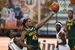 CORRECTS TO SECOND HALF, INSTEAD OF FIRST HALF - Baylor guard Davion Mitchell (45) drives to the basket past Texas guard Andrew Jones (1) during the second half of an NCAA college basketball game Tuesday, Feb. 2, 2021, in Austin, Texas. (AP Photo/Eric Gay)