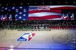 Members of the Boston Celtics and Washington Wizards kneel before the start of an NBA basketball game Thursday, Aug. 13, 2020 in Lake Buena Vista, Fla. (AP Photo/Ashley Landis, Pool)