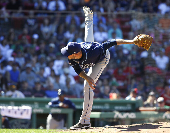 Tampa Bay Rays' Oliver Drake follows through on a pitch against the Boston Red Sox in the seventh inning of a baseball game Sunday, June 9, 2019, in Boston. (AP Photo/Steven Senne)