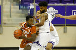 Texas guard Courtney Ramey (3) looks to pass as he is defended by TCU guard Mike Miles (1) and forward Jaedon LeDee (23) during the second half of an NCAA college basketball game in Fort Worth, Texas, Sunday, March 7, 2021. (AP Photo/Michael Ainsworth)