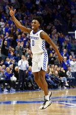 Kentucky's Ashton Hagans (0) celebrates a made shot in the second half of an NCAA college basketball game against Mississippi in Lexington, Ky., Saturday, Feb. 15, 2020. Kentucky won 67-62. (AP Photo/James Crisp)