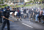 An Austin Police officer sprays pepper spray at protesters, Saturday, May 30, 2020, in Austin, Texas, as demonstrations took place in response to the Memorial Day death of George Floyd while in police custody in Minneapolis. (Ricardo B. Brazziell/Austin American-Statesman via AP)