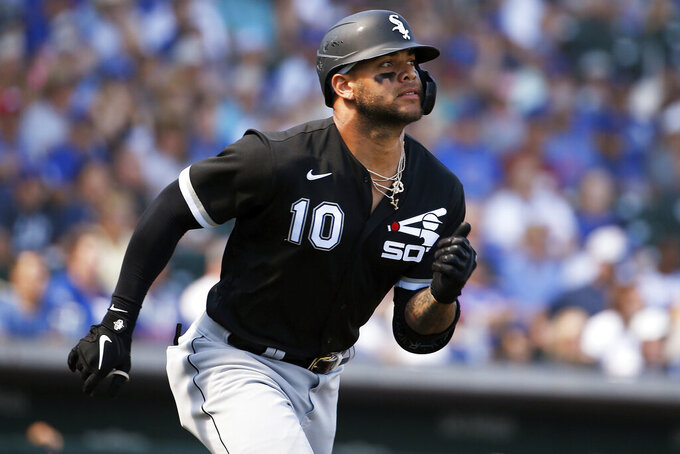 FILE - In this March 6, 2020, file photo, Chicago White Sox third baseman Yoán Moncada runs to first base with a hit in the first inning of the team's spring training baseball game against the Chicago Cubs in Mesa, Ariz. Moncada rejoined the White Sox after missing the start of their summer camp because he contracted the coronavirus. Moncada revealed on a video conference call with reporters Thursday, July 16, that he tested positive for COVID-19. He said he didn't experience any major symptoms but it was a difficult time for him and a little scary. (AP Photo/Sue Ogrocki, File)