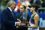 Russian Tennis Federation President Shamil Tarpischev awards Belinda Bencic of Switzerland after her victory over Anastasia Pavlyuchenkova of Russia in the final match of the Kremlin Cup tennis tournament in Moscow, Russia, Sunday, Oct. 20, 2019. (AP Photo/Alexander Zemlianichenko)