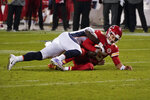 Kansas City Chiefs quarterback Patrick Mahomes (15) is sacked by Denver Broncos outside linebacker Jeremiah Attaochu (97) in the second half of an NFL football game in Kansas City, Mo., Sunday, Dec. 6, 2020. (AP Photo/Charlie Riedel)
