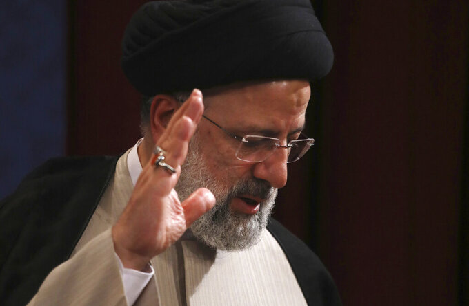 In this June 21, 2021, photo, Iran's new President-elect Ebrahim Raisi waves at the conclusion of his news conference in Tehran, Iran. Biden administration officials are insisting that the election of a hard-liner as Iran's president won't affect prospects for reviving the faltering 2015 nuclear deal with Tehran. But there are already signs that their goal of locking in a deal just got harder. (AP Photo/Vahid Salemi)
