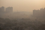 """Morning haze envelops the skyline on the outskirts of New Delhi, India, Friday, Oct. 16, 2020. The Indian capital's air quality levels plunged to """"very poor"""" on Friday, days after the state government initiated stricter measures to fight chronic air pollution. A smoggy haze settled over the city, reducing visibility, as the Air Quality Index rose past 270, according to SAFAR, India's main environment monitoring agency. The World Health Organization deems anything above 25 as unsafe. (AP Photo/Altaf Qadri)"""