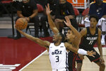 Utah Jazz guard Trent Forrest (3) shoots against Miami Heat center Omer Yurtseven during the first half of an NBA summer league basketball game Friday, Aug. 13, 2021, in Las Vegas. (AP Photo/David Becker)