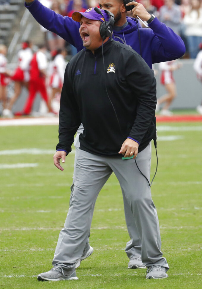 East Carolina interim head coach David Blackwell directs the team during the first half of NCAA college football game in Raleigh, N.C., Saturday, Dec. 1, 2018. (AP Photo/Chris Seward)
