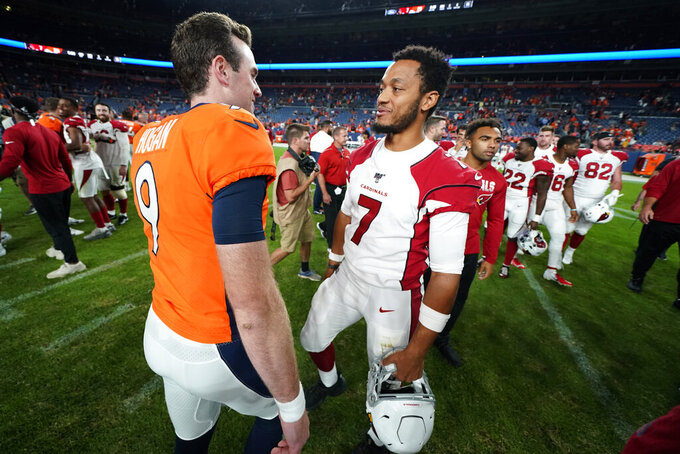 Denver Broncos quarterback Kevin Hogan (9) greets Arizona Cardinals quarterback Brett Hundley after an NFL preseason football game, Thursday, Aug. 29, 2019, in Denver. The Broncos won 20-7. (AP Photo/Jack Dempsey)