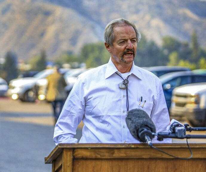 FILE - In this Aug. 14, 2020, file photo, William Perry Pendley, acting director of the Bureau of Land Management, speaks to the media on the Grizzly Creek Fire in Eagle, Colo. A federal judge has ruled that the Trump administration's leading steward of public lands has been serving unlawfully and blocked him from continuing in the position. U.S. District Judge Brian Morris said Friday, Sept. 25, 2020, that U.S. Bureau of Land Management acting director William Perry Pendley was never confirmed to the post by the U.S. Senate and served unlawfully for 424 days. Montana's Democratic governor had sued to remove Pendley, saying the the former oil industry attorney was illegally overseeing a government agency that manages almost a quarter-billion acres of land, primarily in the U.S. West. (Chris Dillmann/Vail Daily via AP, File)