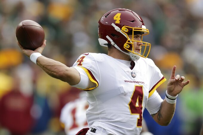 Washington Football Team's Taylor Heinicke throws during the second half of an NFL football game against the Green Bay Packers Sunday, Oct. 24, 2021, in Green Bay, Wis. (AP Photo/Matt Ludtke)