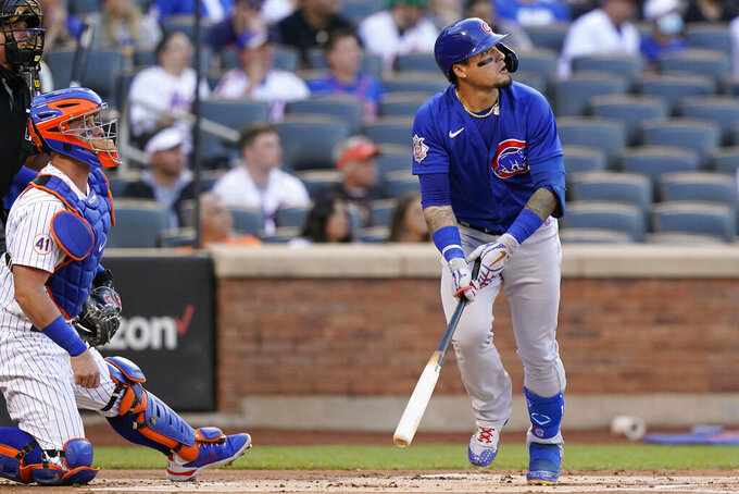 New York Mets catcher James McCann, second from left, and Chicago Cubs' Javier Baez, right, watch Baez's first-inning two-run home run during a baseball game, Thursday, June 17, 2021, in New York. (AP Photo/Kathy Willens)